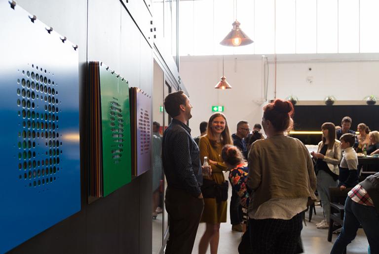 People socialising at a Qb Studios art event